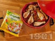 Печени пилешки бутчета с кускус, ориз, чери домати, маслини и зеленчуци в тажин на фурна